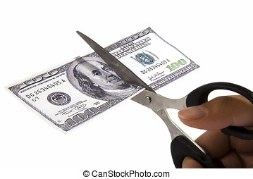 Cutting Spending - Scissors cutting an one hundred dollar...