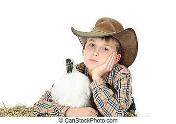 Country boy with farm animal with copyspace - Country boy...