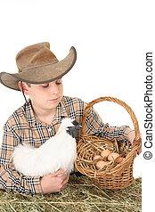 Farm boy with basket of eggs