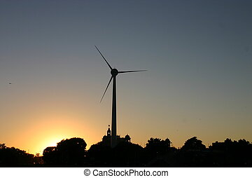 windmill at sunset with silhouetted trees