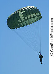 Paratrooper - A Paratrooper Descends in a Clear Blue Sky.