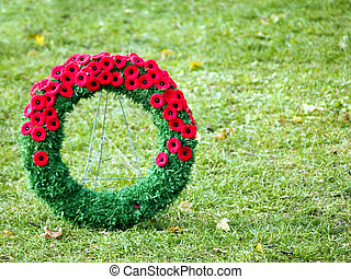 Single wreath on grass - Poppy wreath at a war memorial on...