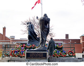 War Memorial - Poppy wreaths at a war memorial on...