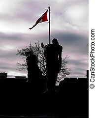 War memorial silhouette - War memorial on remembrance day,...