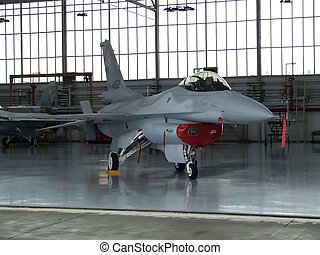 Plane - F16 military aircraft in a hangar