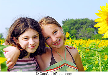 Two girls - Portrait of two young girls in a sunflower field