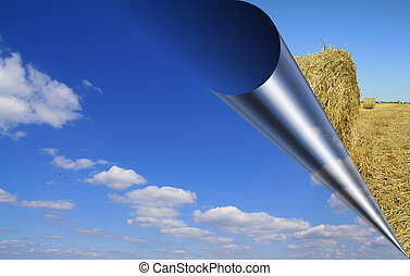 Rolled-up sky, harvest background beyond