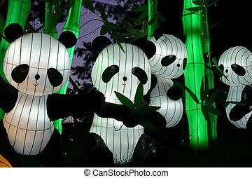 Pandas - pandas and bamboo during chinese lantern festival...