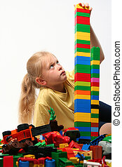 Cube blocks - Little girl playing with colorful cube blocks...