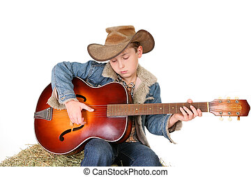 Boy strumming guitar - A boy strums a tune on an acoustic...