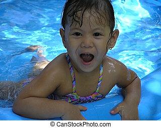 kid in kiddie pool - kid swimming in inflatable kiddie pool...