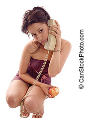 Call phone apple - Young brunette girl eating a apple and...