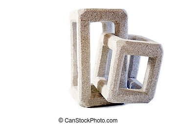 Brain teaser. - Two piece of intermingled concrete puzzle on...
