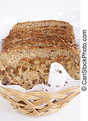 Loaf of seedy bread - Slices of seedy bread on a basket