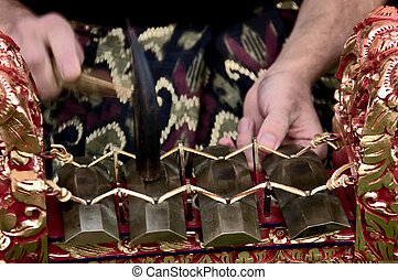 Gamelan Player - The hands of a gamelan player in motion