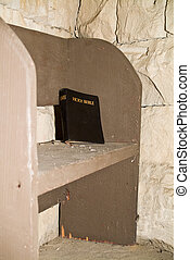 Left on the Pew - A bible left behind on an old dusty pench...