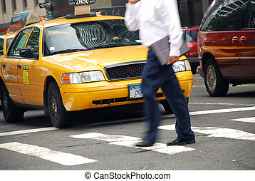Crossing the street - Picture of a businessperson crossing...