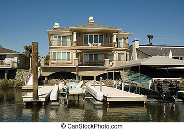 Waterfront home with boats