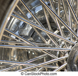 Spokes - Close up of spokes of a wire chrome wheel on a...