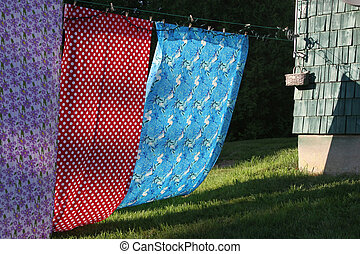 Colorful Clothesline - Very different colorful sheets on a...