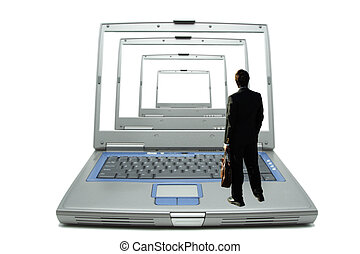 Businessman - A businessman looking at laptops with tunnel...