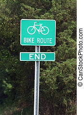 Bike Route Sign with trees in the background