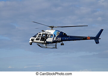 police helicopter - blue and white police helicopter flying...