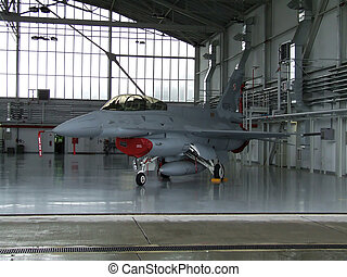 F-16 - F - 16 military aircraft in a hangar