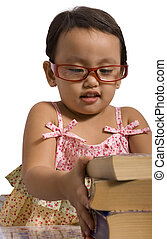 Toddler stacking books - Toddler wearing glasses stacking...