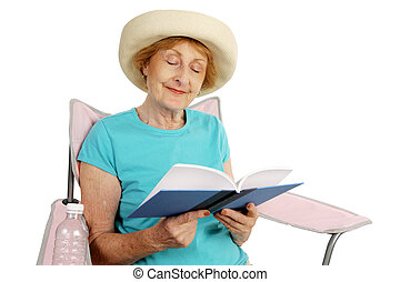 Summer Senior - Reading - A pretty senior lady lounging in a...