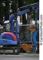 blue power shovel along side of a road