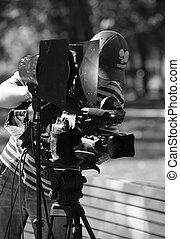 Cameraman with a videocamera works