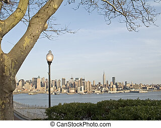 NYC View - A view of the New York City skyline from a park...