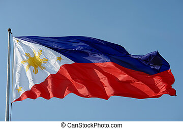 Flag of the Philippines over an azure blue sky.