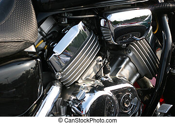 V Twin - A closeup of a chromed two cylinder motorcycle...