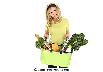 Shopping bag full of groceries - A girl holding an eco...