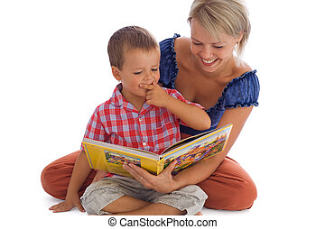 Enjoying the fairy tale - Woman and her little boy having...