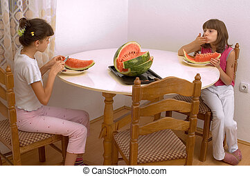 Eating watermelon - Young child girl eating watermelon in...