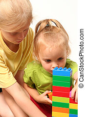 Cube blocks - Little children playing with colorful cube...