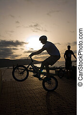 young with Bicycle - young in bicycle jump in street trial...