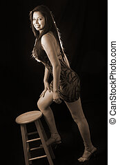 Standing on a stool - beautiful brown hair woman wearing...