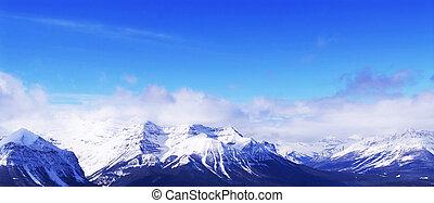 Snowy mountains - Snowy mountain ridges at Lake Louise ski...