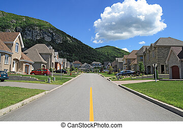 Rich neighborhood - Street leading to the mountain in a rich...