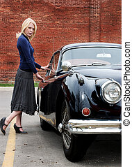 Stepping out in style - A beautiful blond woman getting into...
