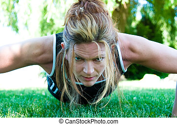 Staying Fit - Pushup - A woman doing pushups in the park