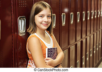 Student by Lockers - A pretty school girl leaning against...