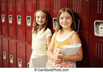 Students by Lockers - Two adolescent school girls in front...