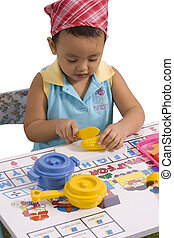 A pretty little girl playing