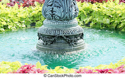 Teal Green Fountain water - Fountain surrounded by colorful...