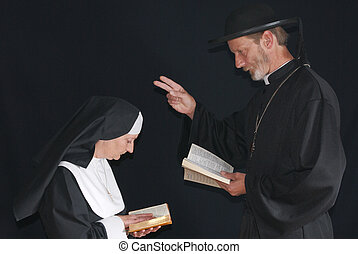 Praying nun and priest - Middle aged devout nun and priest...